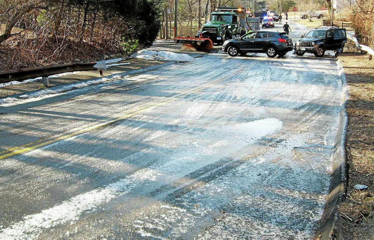 In this Thursday, Jan. 9, 2014 photo, released by the Norwalk Police Department, a sheet of ice covers Flax Hill Road in Norwalk, Conn. Alfredo Bahena-Benitez, a pool company worker, was arrested on charges that he drained a swimming pool in freezing temperatures onto the road, causing several car crashes. (AP Photo/Norwalk Police Department)