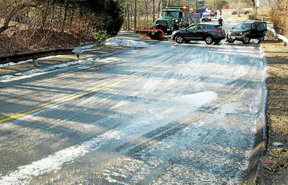 In this Thursday, Jan. 9, 2014 photo, released by the Norwalk Police Department, a sheet of ice covers Flax Hill Road in Norwalk, Conn. Alfredo Bahena-Benitez, a pool company worker, was arrested on charges that he drained a swimming pool in freezing temperatures onto the road, causing several car crashes. (AP Photo/Norwalk Police Department) Photo: AP / Norwalk Police Department