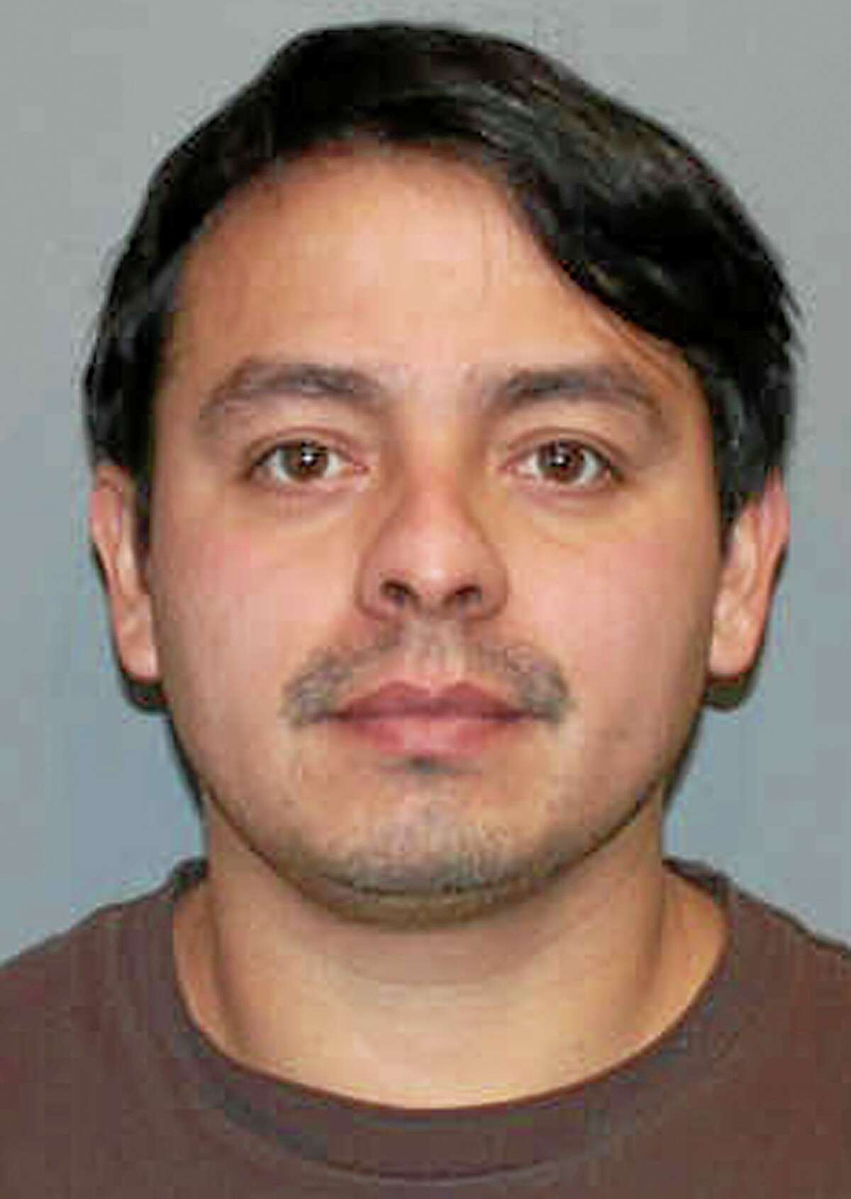 This booking photo released Friday, Jan. 10, 2014 by the Norwalk Police Department shows Alfredo Bahena-Benitez, a pool company worker arrested on charges that he drained a swimming pool in freezing temperatures onto Flax Hill Road in Norwalk, Conn., causing several car crashes. (AP Photo/Norwalk Police Department)