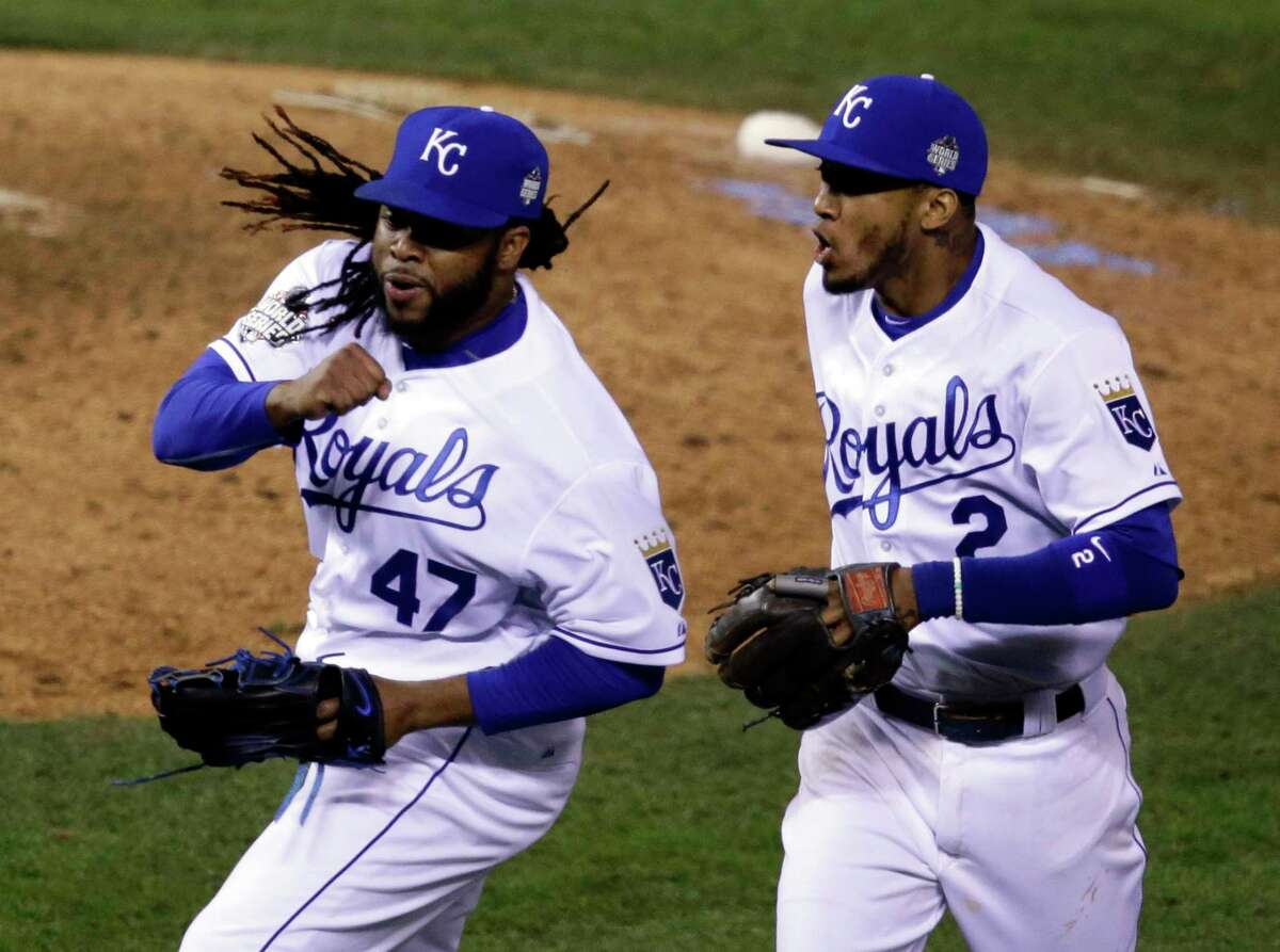 Royals pitcher Johnny Cueto (47) and Alcides Escobar (2) celebrate in the eighth inning of Game 2 of the World Series against the New York Mets.