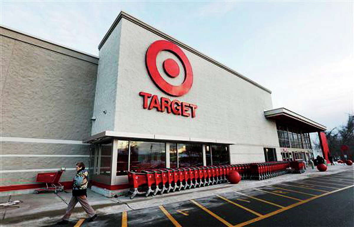 FILE - In this Dec. 19, 2013 file photo, a passer-by walks near an entrance to a Target retail store in Watertown, Mass. Target on Friday, Dec. 27, 2013 said that customers' encrypted PIN data was removed during the data breach that occurred earlier this month. But the company says it believes the PIN numbers are still safe because the information was strongly encrypted. (AP Photo/Steven Senne, File)