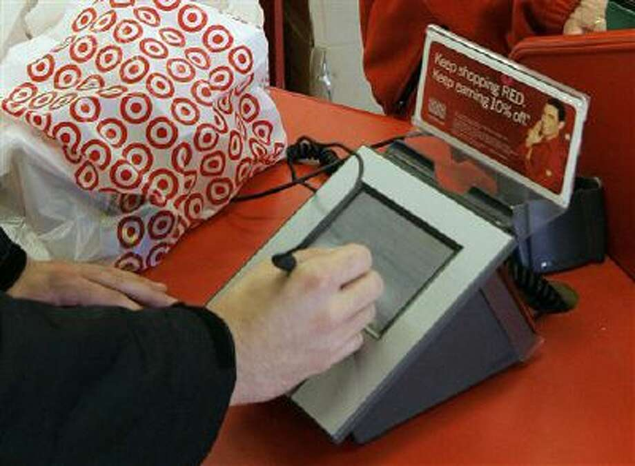 A customer signs his credit card receipt at a Target store in Tallahassee, Fla. Photo: AP / AP