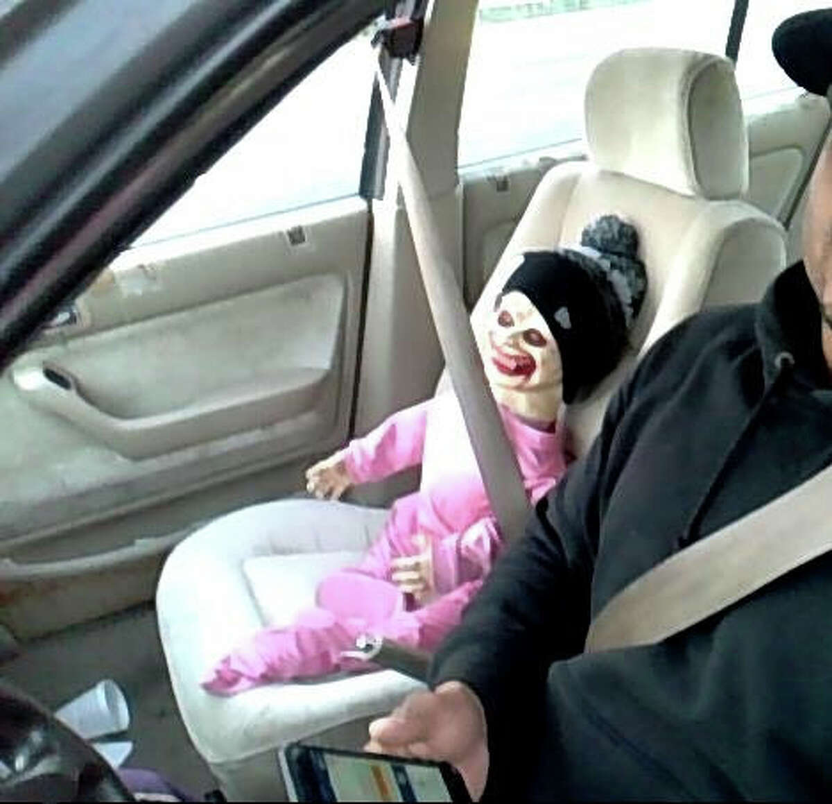 This photo provided by Washington State Patrol shows a Halloween doll buckled up in the passenger seat of a car on Oct. 27, 2015 in Tacoma, Wash. During Tuesday's morning commute, a trooper pulled over the man after he tried to use the doll to gain access to the HOV lane of Interstate 5 in Tacoma.