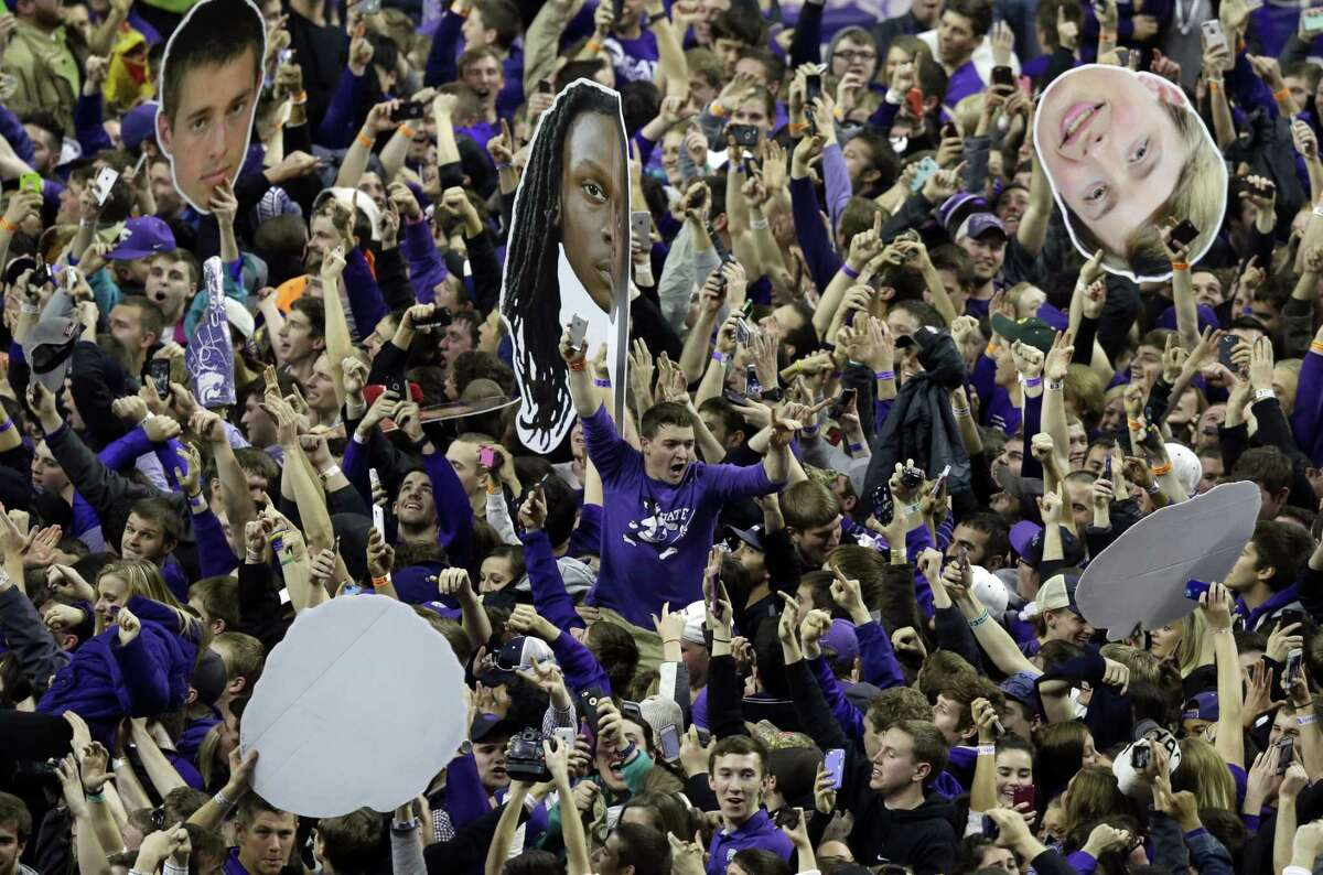 Kansas State fans celebrate following a win over Kansas at Bramlage Coliseum on Monday in Manhattan, Kan. Register sports columnist Chip Malafronte is calling for an end to court storming, but not just because it's potentially dangerous. It's also become cliched. Think of something new, student stormers!