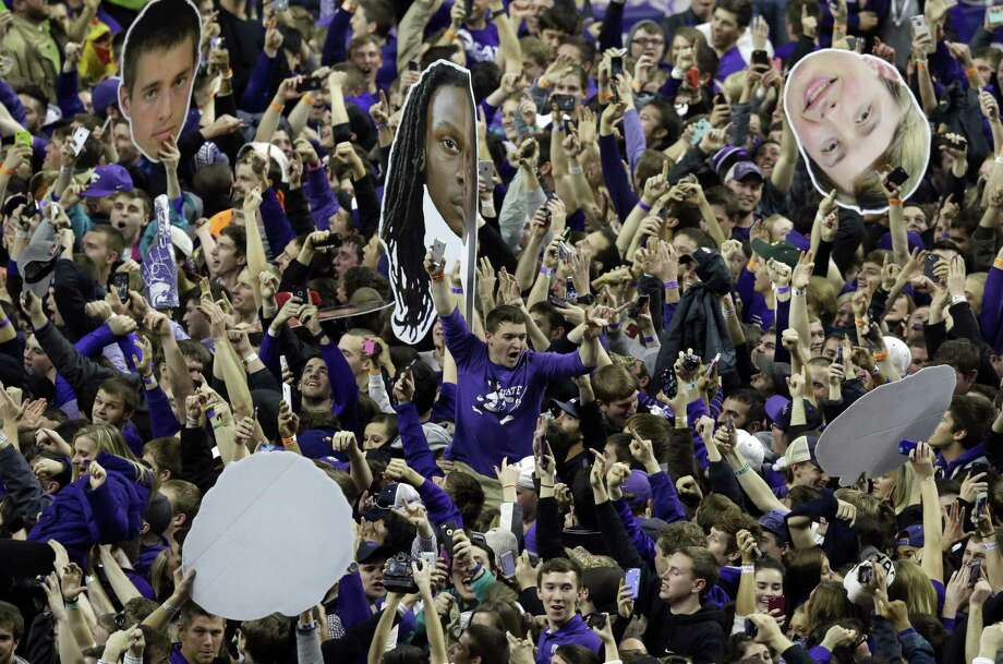 Kansas State fans celebrate following a win over Kansas at Bramlage Coliseum on Monday in Manhattan, Kan. Register sports columnist Chip Malafronte is calling for an end to court storming, but not just because it's potentially dangerous. It's also become cliched. Think of something new, student stormers! Photo: Orlin Wagner — The Associated Press  / AP