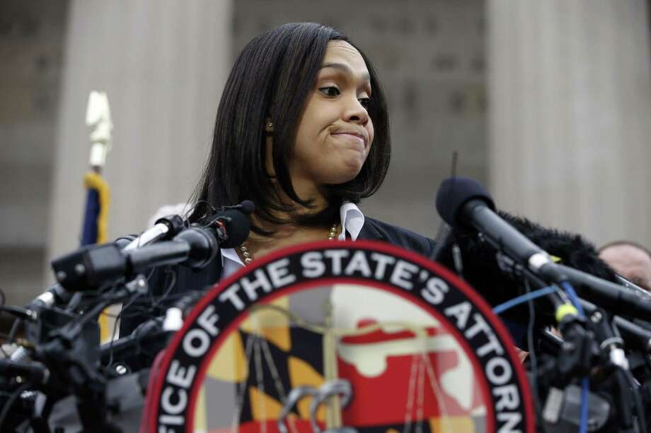 Marilyn Mosby, Baltimore state's attorney, pauses while speaking during a media availability, Friday, May 1, 2015 in Baltimore. Mosby announced criminal charges against all six officers suspended after Freddie Gray suffered a fatal spinal injury while in police custody. Photo: (AP Photo/Alex Brandon) / AP