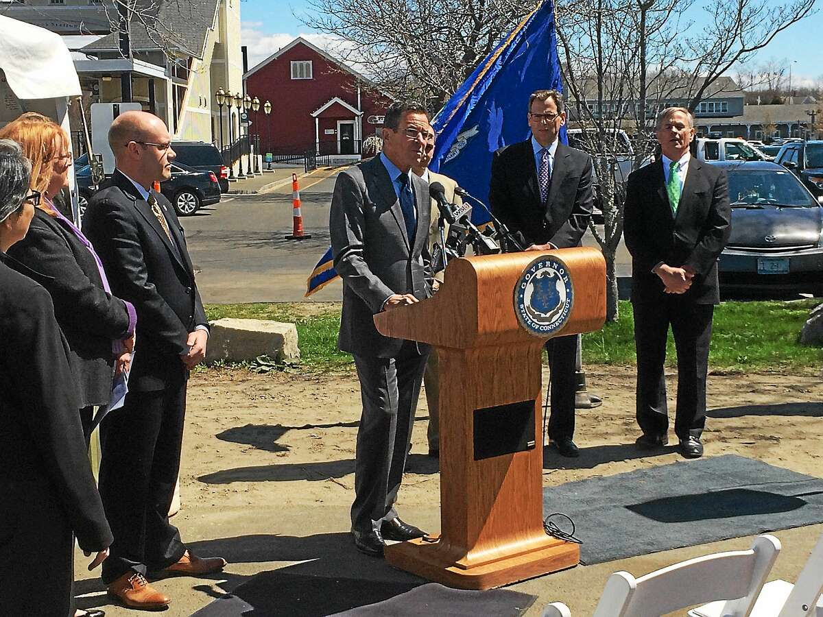 Gov. Dannel P. Malloy held a press conference Wednesday at the Old Saybrook station to announce that recent improvements include more parking, a new bus shelter and electric vehicle charging stations.