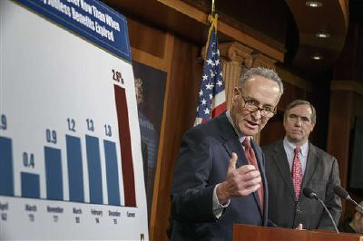 Sen. Charles Schumer, D-N.Y., joined at right by Sen. Jeff Merkley, D-Ore., meets with reporters after legislation to renew jobless benefits for the long-term unemployed unexpectedly cleared an initial Senate hurdle on Tuesday.