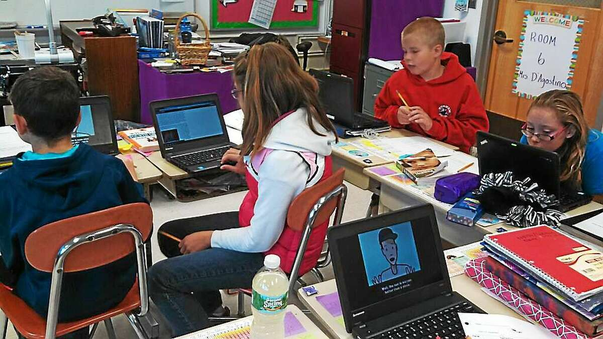Fifth-graders in Mrs. D'Agostino's class at Memorial School in Middlefield research videos online.