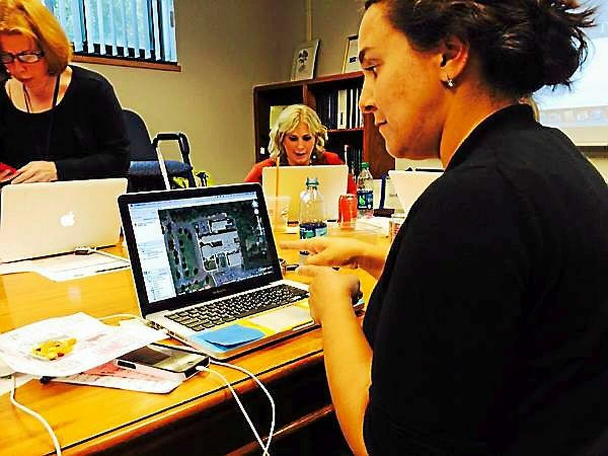 Teachers use Google Earth to plan for the upcoming professional development day.