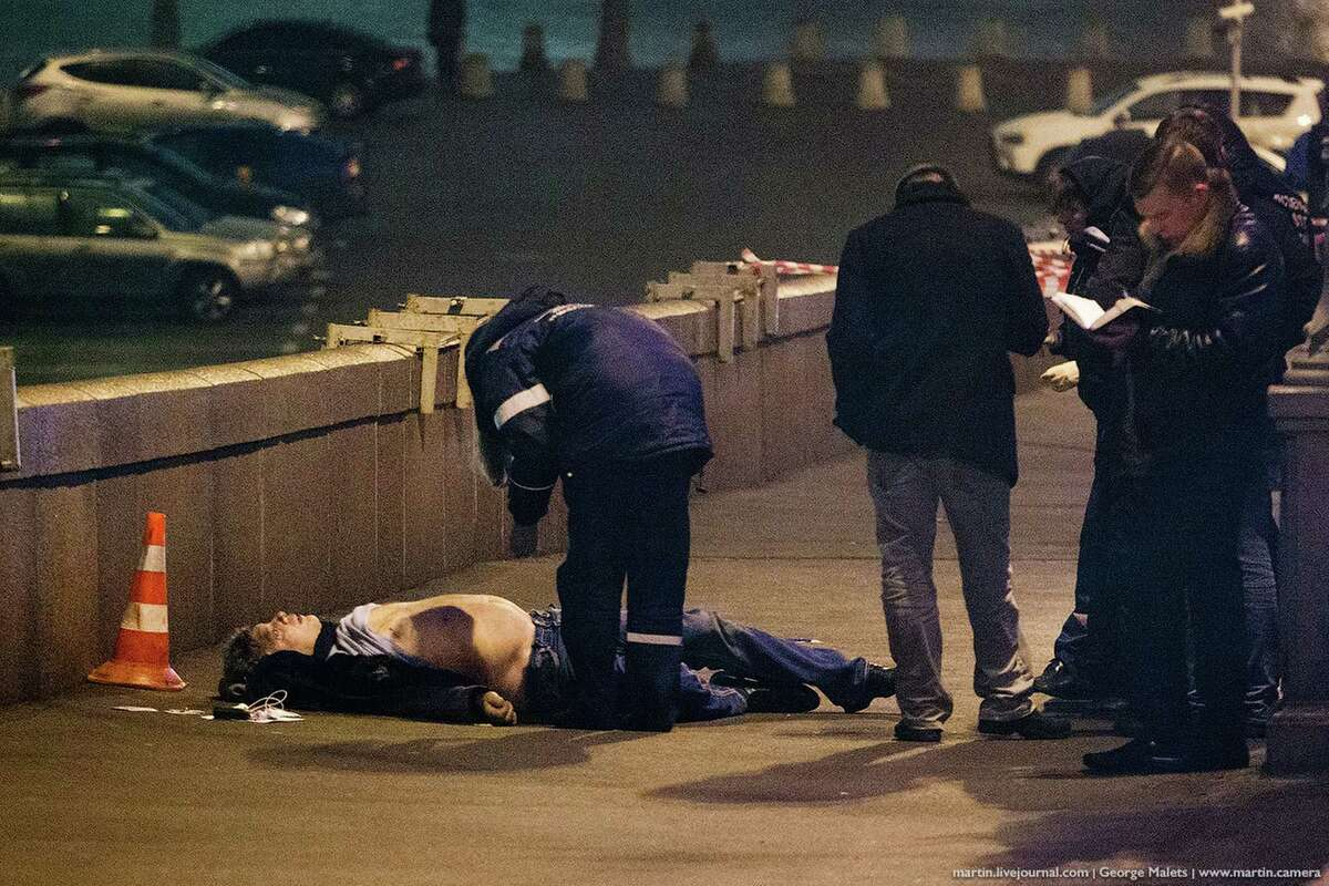 EDS NOTE NUDITY, GRAPHIC CONTENTS - Police investigate the body of Boris Nemtsov, an opposition leader and a former deputy prime minister, at Red Square in Moscow, Russia on Saturday, Feb. 28, 2015. Russia's Interior Ministry says Nemtsov was shot and killed near the Kremlin shortly after midnight. His death comes just a day before a planned protest against President Vladimir Putin's rule. (AP Photo/George Malets)