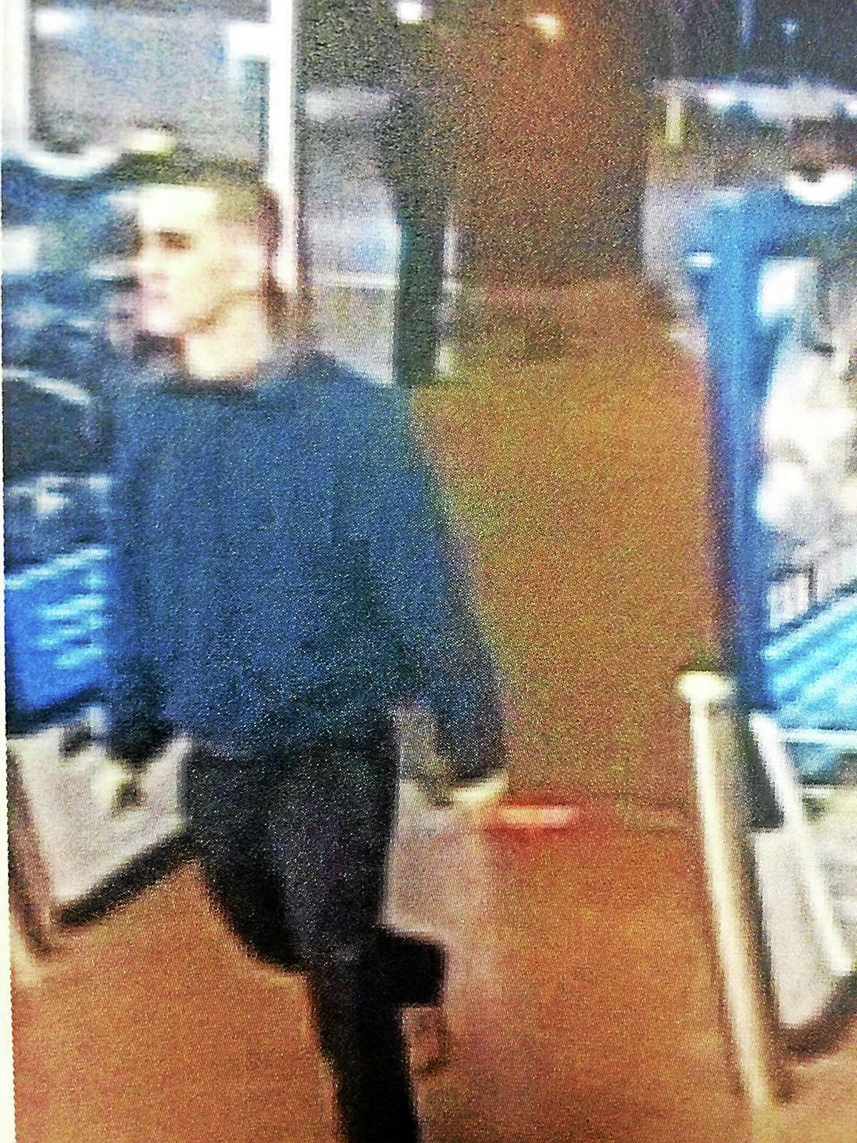 Authorities are searching for two men they say broke into a number of cars last week and stole items.