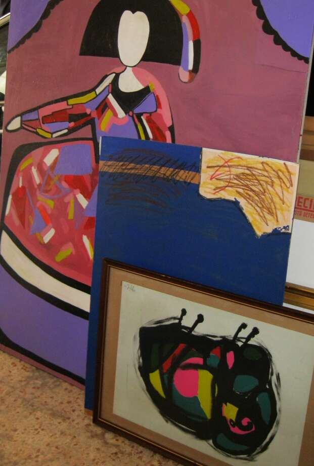In this photo released by the Spanish Interior Ministry on Saturday, Feb. 28, 2015, different pieces of alleged fake art are seen inside a studio in Valencia, Spain. Spanish Police have broken up a network that allegedly created and sold fake works of art purporting to be by artists of international standing including Pablo Picasso, Andy Warhol and Joan Miro. Officers have arrested nine suspects in the eastern region of Valencia, including the alleged counterfeiters and intermediaries involved in selling the fakes. Investigators searched seven addresses and seized 271 works, including canvasses, sculptures and documents to be used to falsify the art's provenance. (AP Photo/Spanish Interior Ministry, HO) Photo: AP / Spanish Interior Ministry