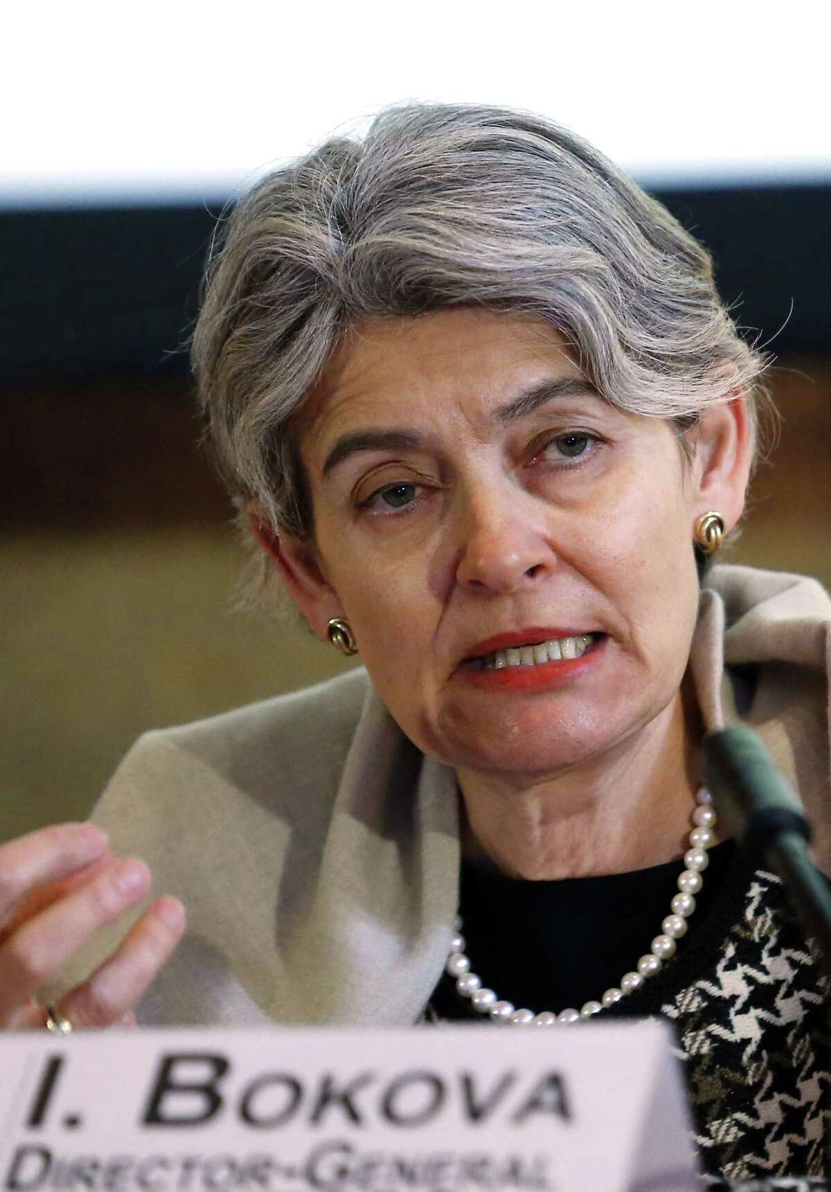 """Irina Bokova, Director General of the U.N.'s culture agency UNESCO, speaks during a press conference in Paris, France, Friday, Feb. 27, 2015. Bokova asked for an emergency meeting of the U.N. Security Council to be convened """"on the protection of Iraq's cultural heritage as an integral element for the country's security"""" after extremists released a video thought to show men using sledgehammers to smash ancient Mesopotamian statues and other artifacts in Iraq's northern city of Mosul.(AP Photo/Jacques Brinon)"""