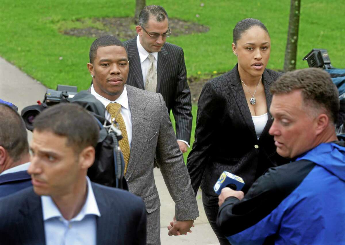 Baltimore Ravens running back Ray Rice holds hands with his wife, Janay Palmer, as they arrive at Atlantic County Criminal Courthouse in Mays Landing, N.J., on Thursday. After Rice and Palmer got into a physical altercation on Feb. 15 at an Atlantic City casino, both were charged with simple assault-domestic violence.
