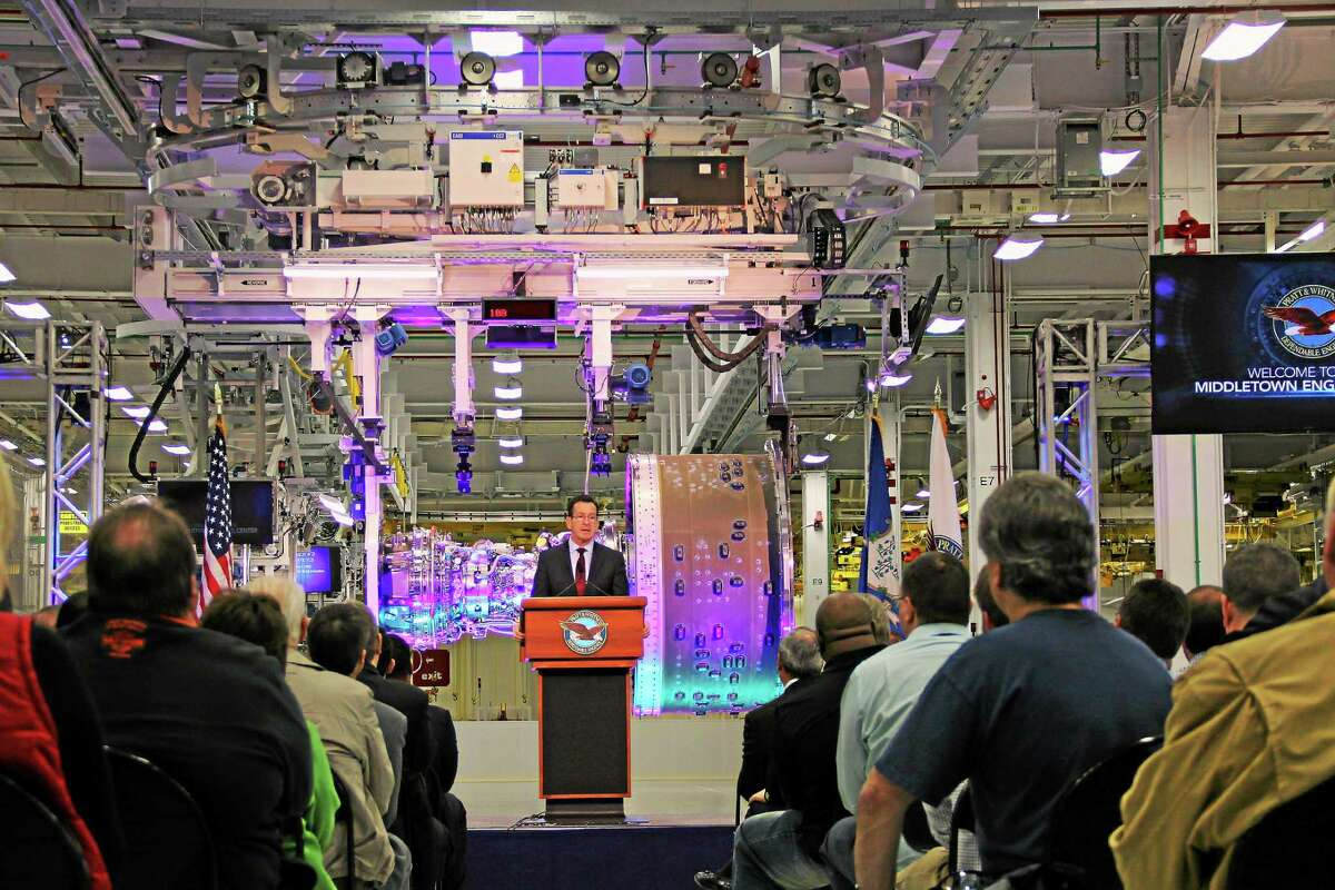 Gov. Dannel Malloy speaks to 350 guests and hundreds of Pratt & Whitney employees at a ribbon-cutting for a new state-of-the-art engine production facility in Middletown.