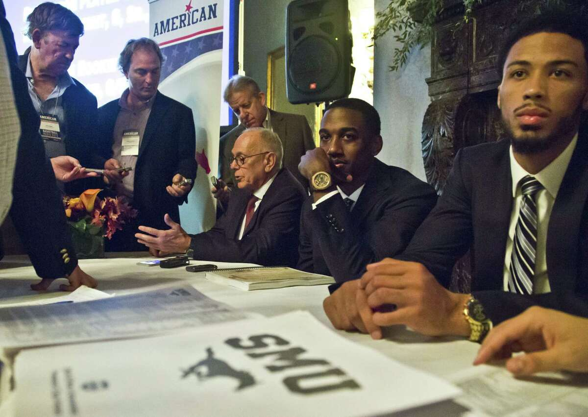 SMU head coach Larry Brown, seated third from right, and Mustangs Ryan Manuel, second from right, and Cannen Cunningham, far right, answer questions during the American Athletic Conference media day on Wednesday in New York.