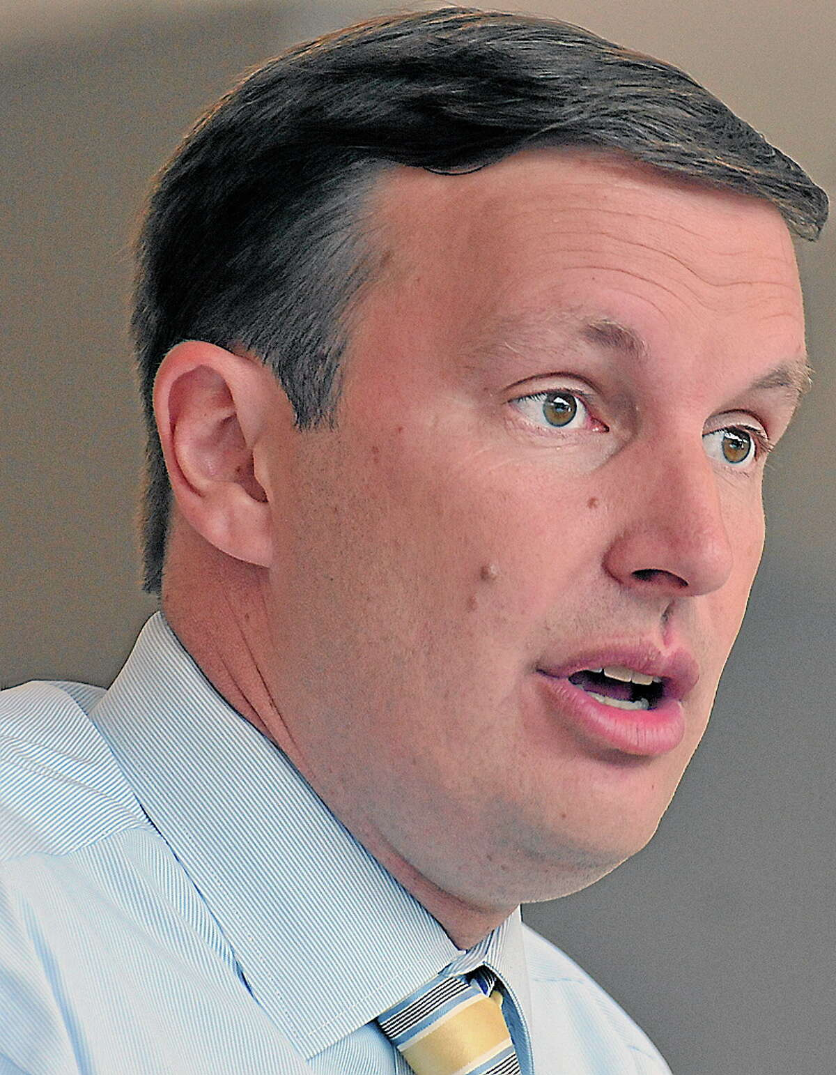 Wallingford-- Senate candidate Chris Murphy speaks to employees and media at Proton OnSite, a Wallingford based company that develops Hydrogen Generation Systems. Murphy hit the campaign trail again after willing the democratic primary and quickly announced that he wants to debate Republican candidate Linda McMahon as soon as next week. Peter Casolino/New Haven Register 8/15/12