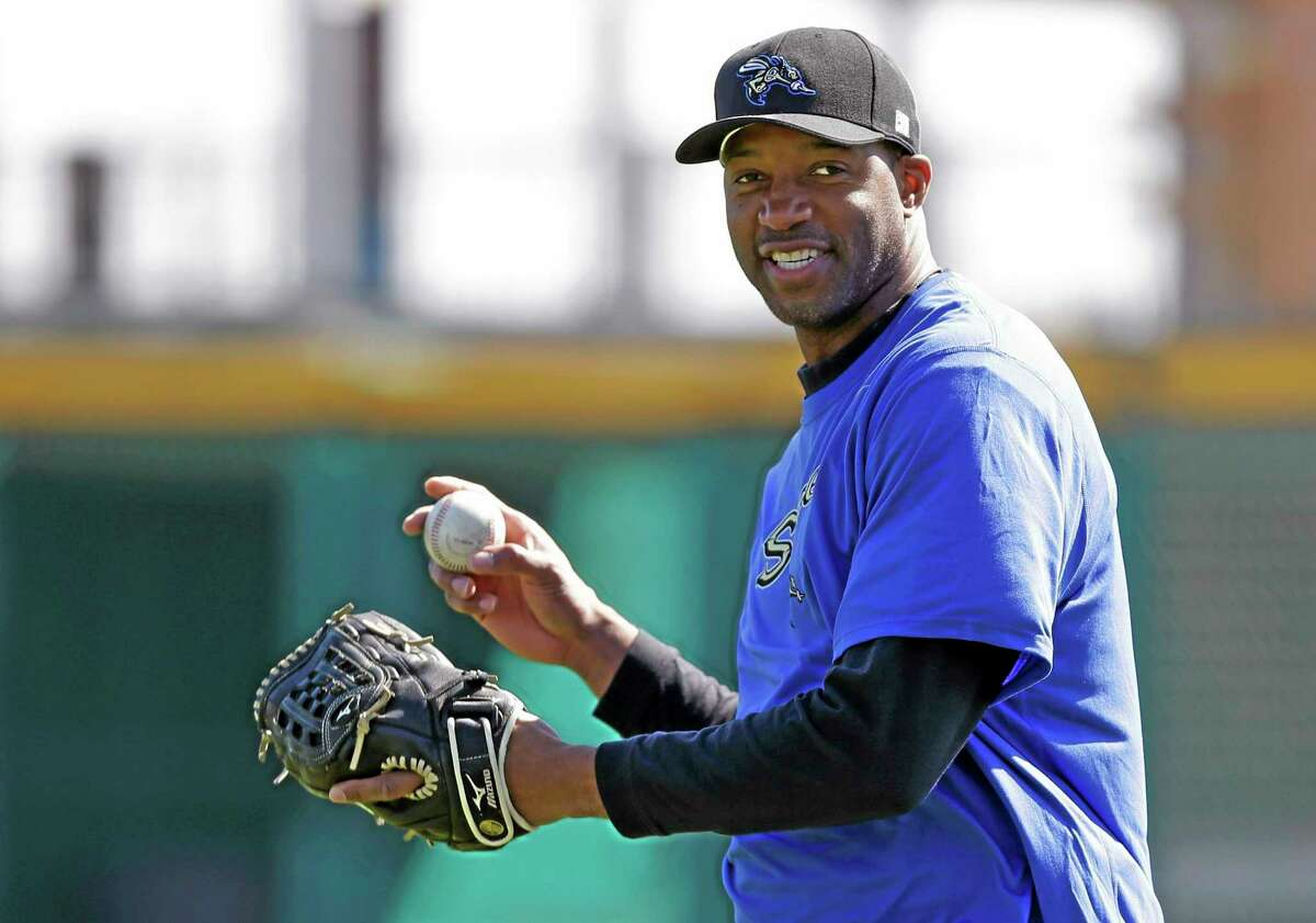 In this Feb. 12 file photo, retired NBA player Tracy McGrady works out at the Sugar Land Skeeters' stadium in Sugar Land, Texas.