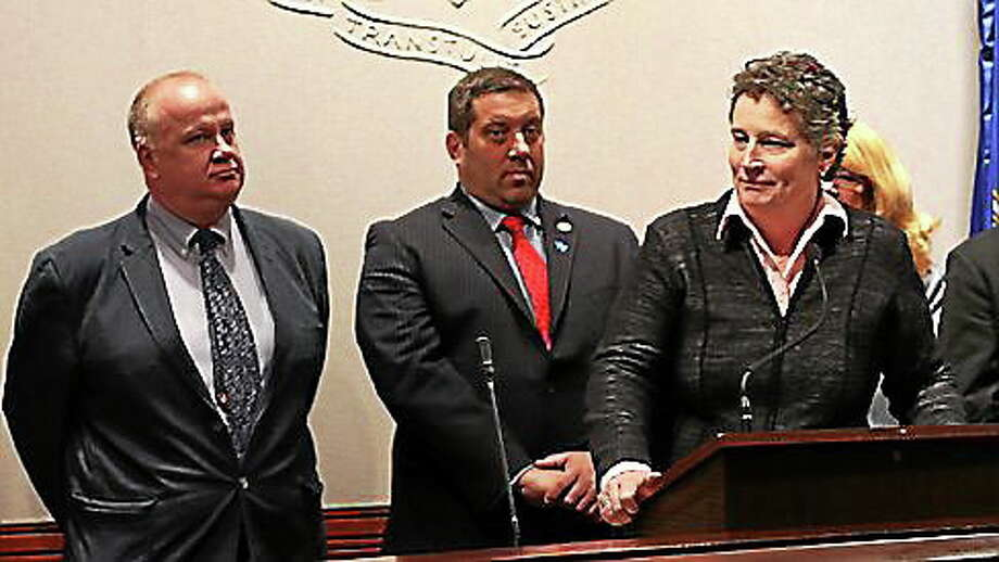 State Sen. Beth Bye (far right) with state Reps. John Hampton and Jay Case Photo: Photo By Christine Stuart