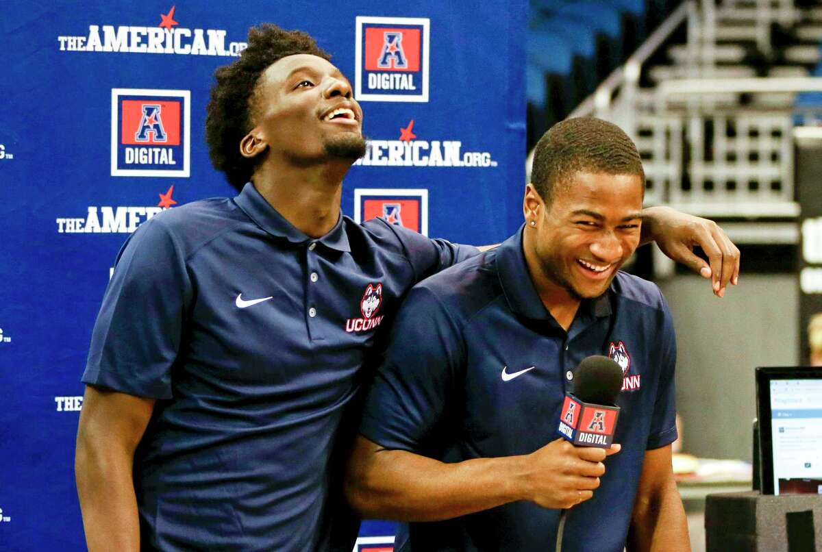 UConn's Daniel Hamilton, left, was named to the AAC preseason first team while last year's leading scorer Rodney Purvis, right, did not garner any preseason recognition. UConn was picked second in the conference behind SMU.