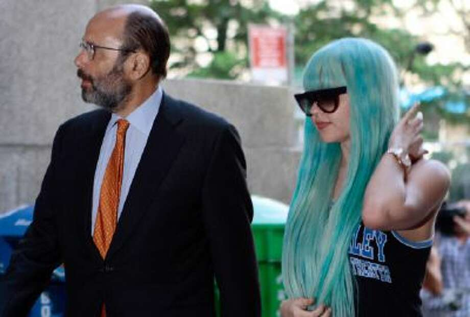 In this Tuesday, July 9, 2013 photo Amanda Bynes, accompanied by attorney Gerald Shargel, arrives for a court appearance in New York on allegations that she chucked a marijuana bong out the window of her 36th-floor Manhattan apartment.