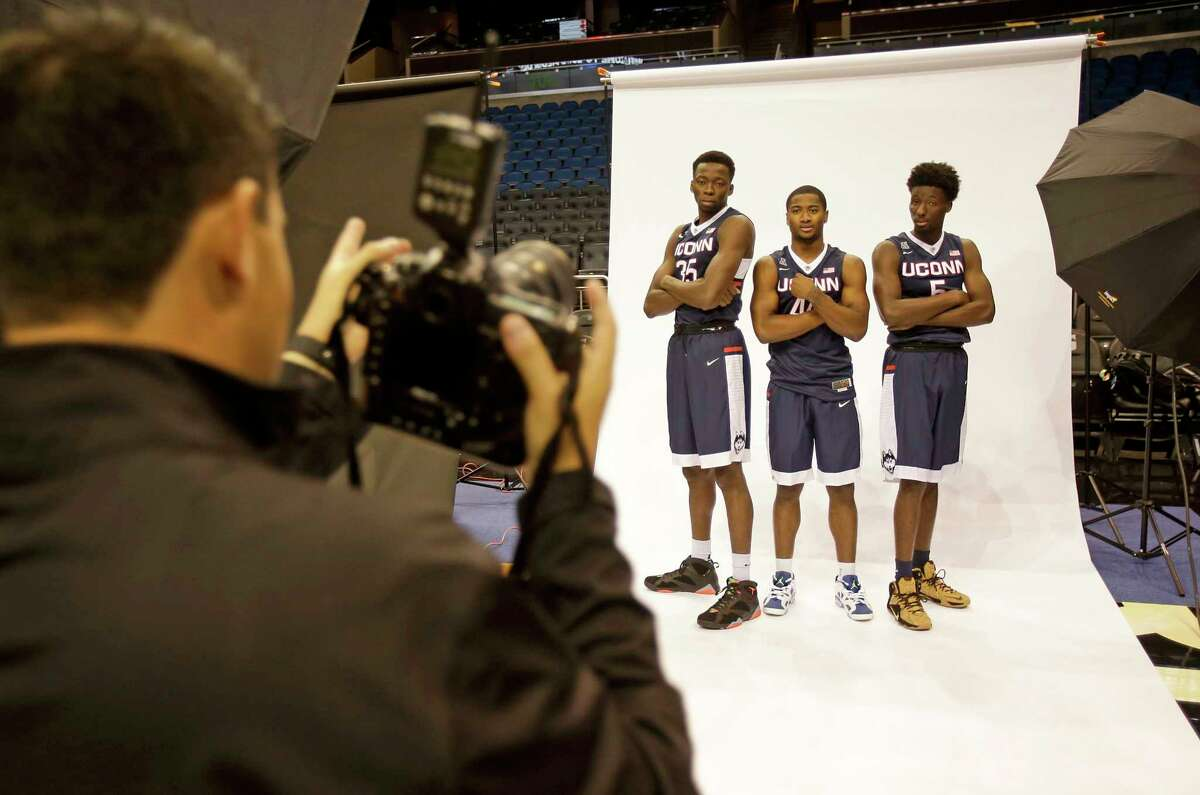 UConn players, from left, Amida Brimah, Rodney Purvis and Daniel Hamilton pose for a photographer during AAC media day on Tuesday in Orlando, Fla.