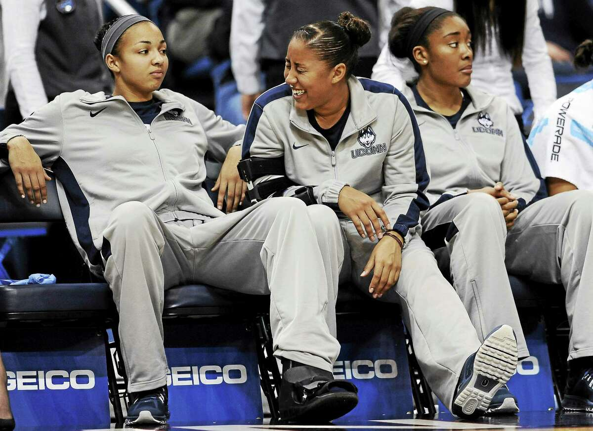 UConn's Kaleena Mosqueda-Lewis, center, and Kiah Stokes, left, will be honored at Senior Day on Saturday. At right is Morgan Tuck.
