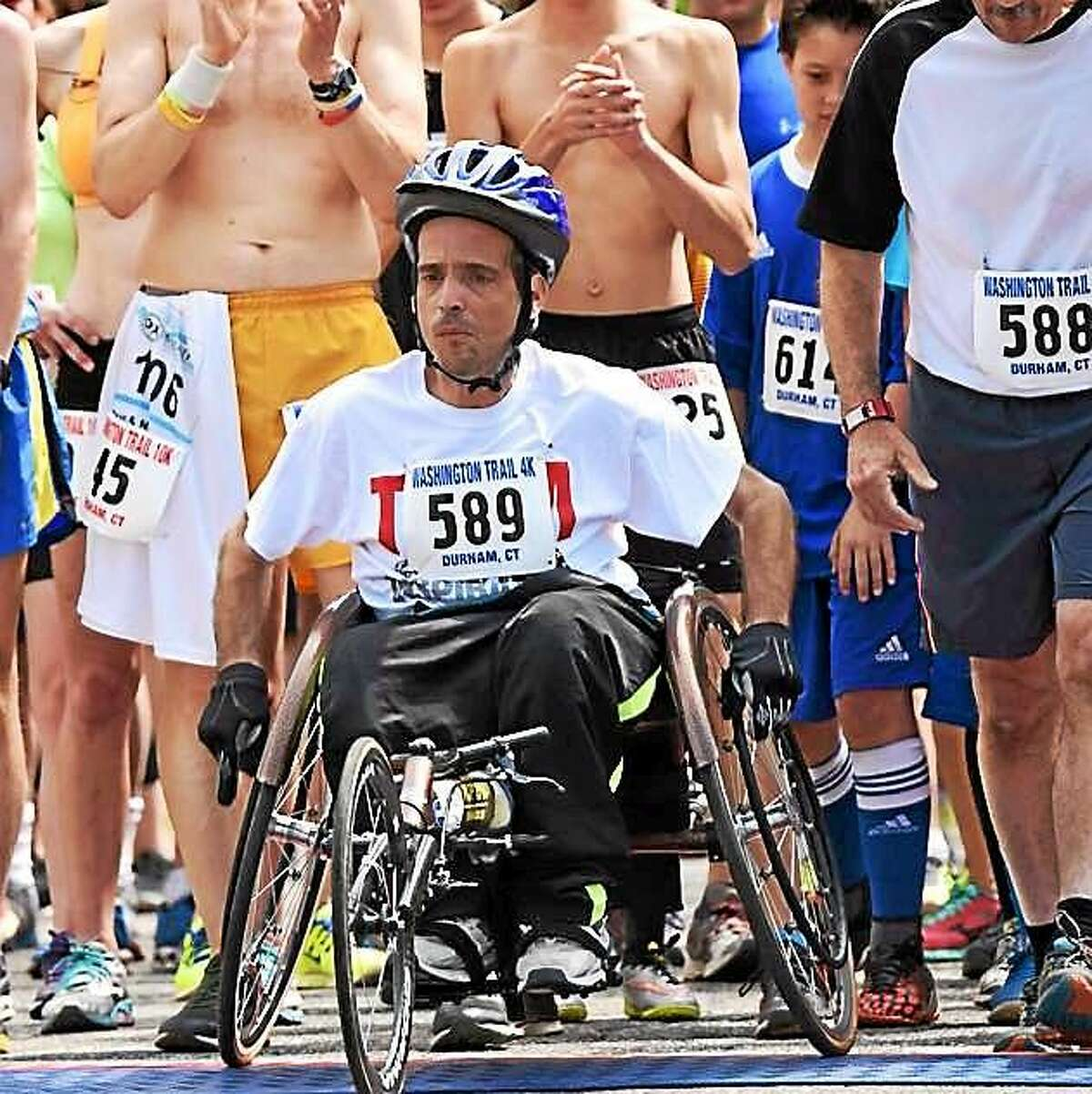 Road racer Steve Anastasio is vying for a spot on the cover of Runner's World. His submitted shot shows Anastasio high-fiving a young spectator from his racing wheelchair during the Hilltop 10K in Leicester, Massachusetts.