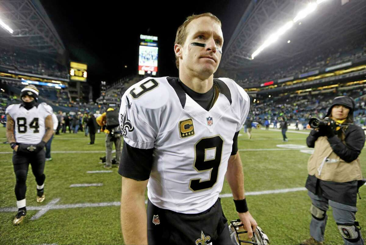 In this Dec. 2 file photo, New Orleans Saints quarterback Drew Brees walks off the field after a 34-7 loss to the Seahawks in Seattle. Register gambling writer Dan Nowak thinks Brees' facial expression will be decidedly different Saturday after the Saints pull off the upset.