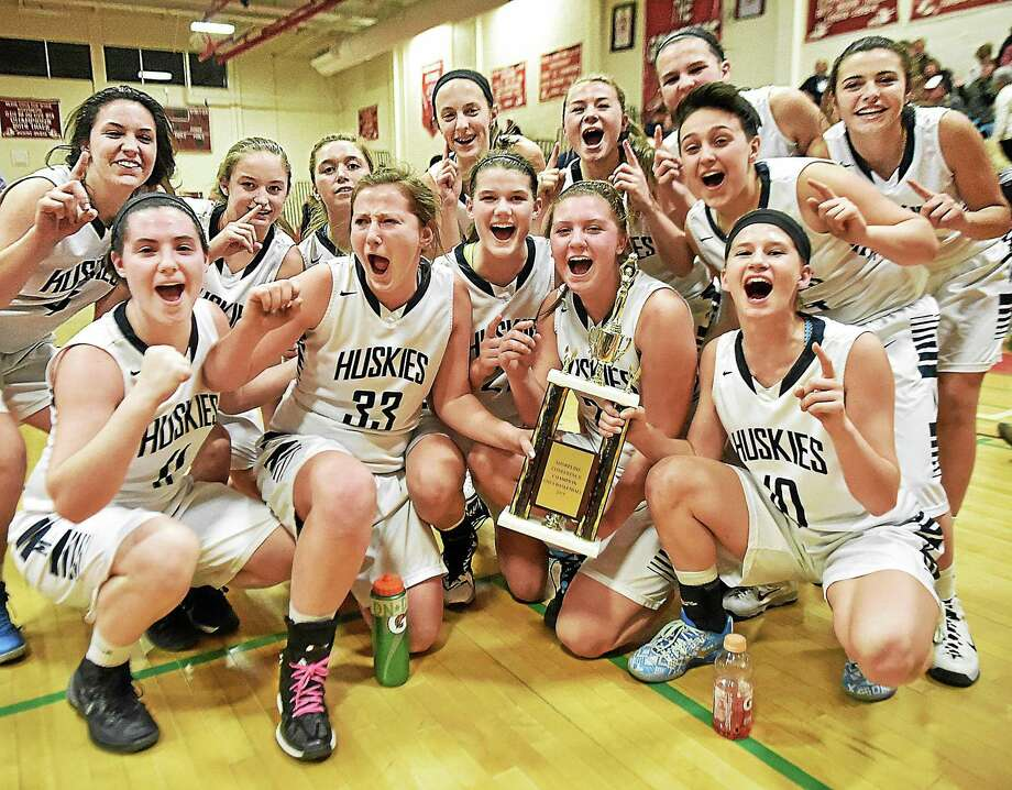 Morgan defeated Cromwell 53-52 in overtime Friday to win the Shoreline girls basketball championship. Photo: Catherine Avalone — New Haven Register  / New Haven RegisterThe Middletown Press