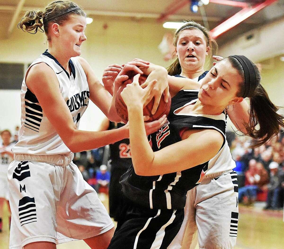 Cromwell's Alyssa Wright battles Morgan's Josie Sullivan, at left and Jen Dawson in the Shoreline girls basketball championship Friday night. Morgan won 53-52.