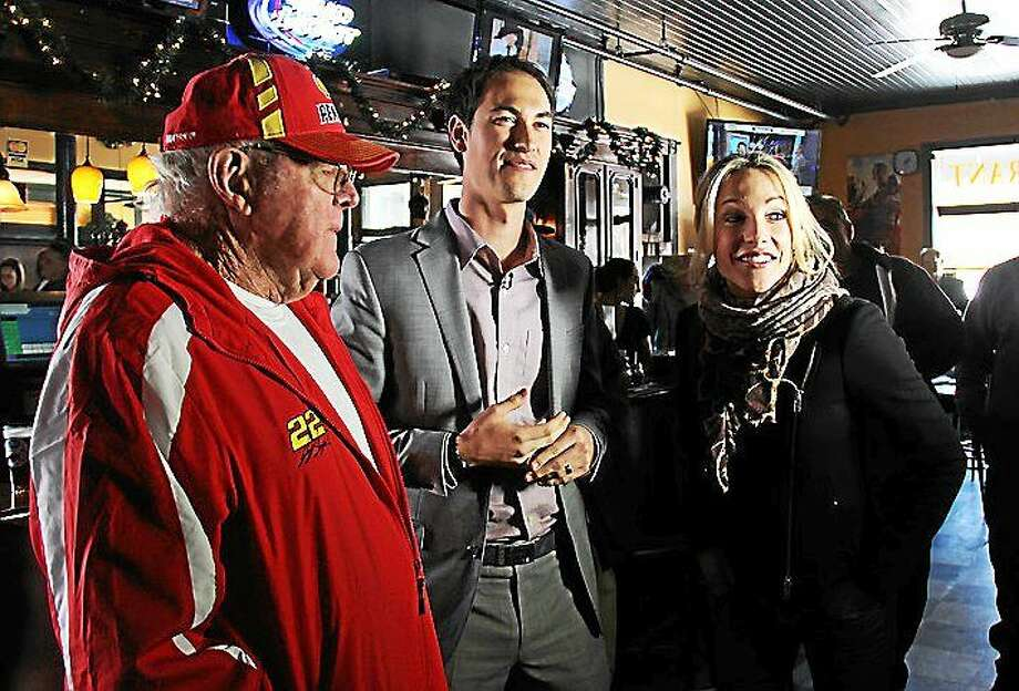 Daytona 500 champion Joey Logano made a visit to the Portland Restaurant on Tuesday. Pictured, from left, Duffy, Logano, and ESPN anchor Lindsay Czarniak. Photo: Kathleen Schassler — The Middletown Press  / """"