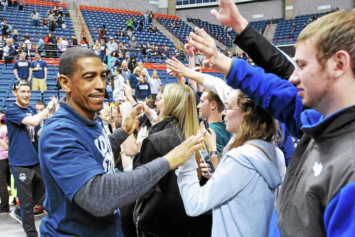 UConn coach Kevin Ollie, here receiving congratulations in Storrs following the Huskies' national title, and his staff hit the recruiting trail recently looking for the next group of Huskies.