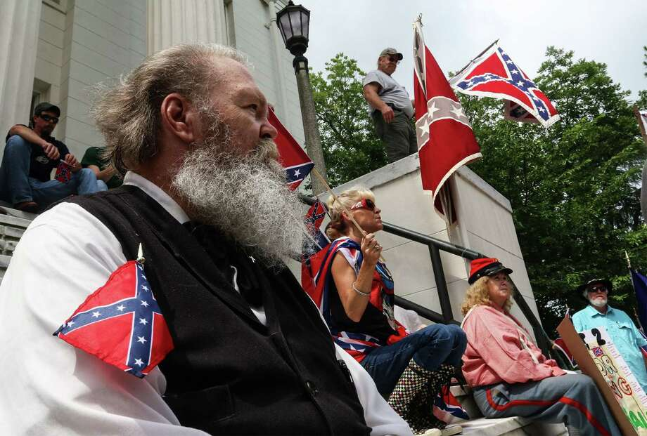 Henry Howard listens to speakers on the steps of the Alabama state capitol building on June 27 in Montgomery, Ala. The rally was held by locals and members of several Southern heritage organizations who oppose the recent removal of Confederate flags from a monument at the capitol honoring Confederate Civil War soldiers. Photo: AP Photo  / AP