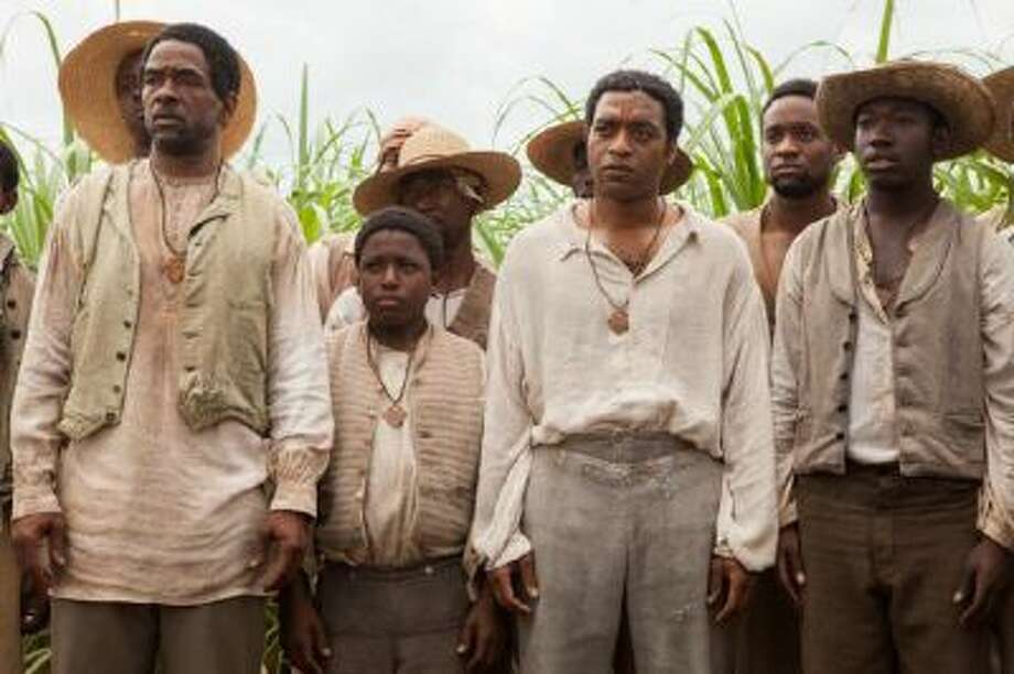 "Chiwetel Ejiofor as Solomon Northup, third from right, in ""12 Years A Slave."""