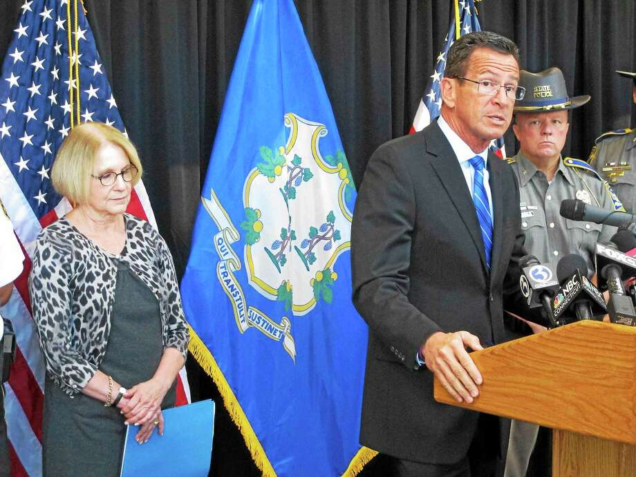 Connecticut Gov. Dannel P. Malloy, front right, discusses a decrease over the previous year in violent crime in the state on Sept. 28, 2015 in Middletown, Conn. Photo: AP Photo/Dave Collins  / AP