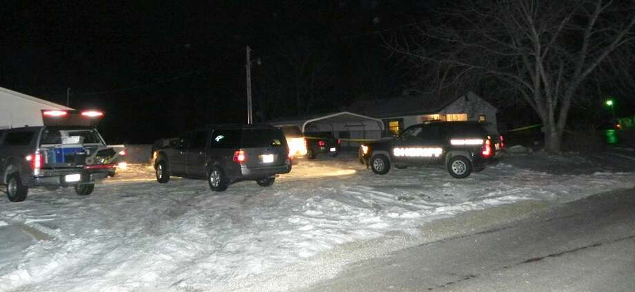 Authorities respond to a house in Tyrone, Mo., at about 5:40 a.m. Friday, Feb. 27, 2015. Authorities say multiple people were shot to death and one was wounded in attacks in a small southeastern Missouri town, and the suspected gunman was found dead from an apparent self-inflicted gunshot wound. (AP Photo/Houston Herald, Doug Davison) Photo: AP / Houston Herald