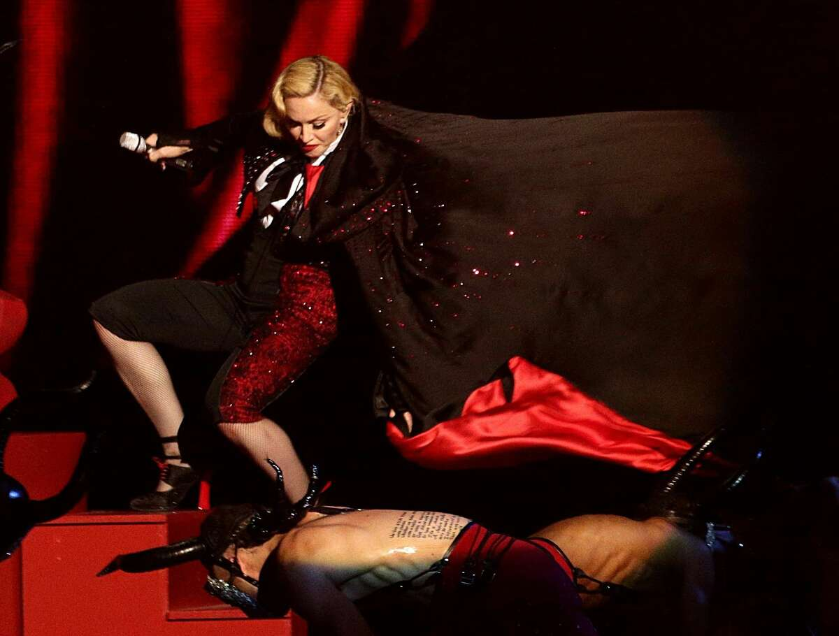 Madonna stumbles whilst performing on stage during the Brit Awards 2015 at the 02 Arena in London, Wednesday, Feb. 25, 2015. (AP Photo/PA, Yui Mok) UNITED KINGDOM OUT NO SALES NO ARCHIVE