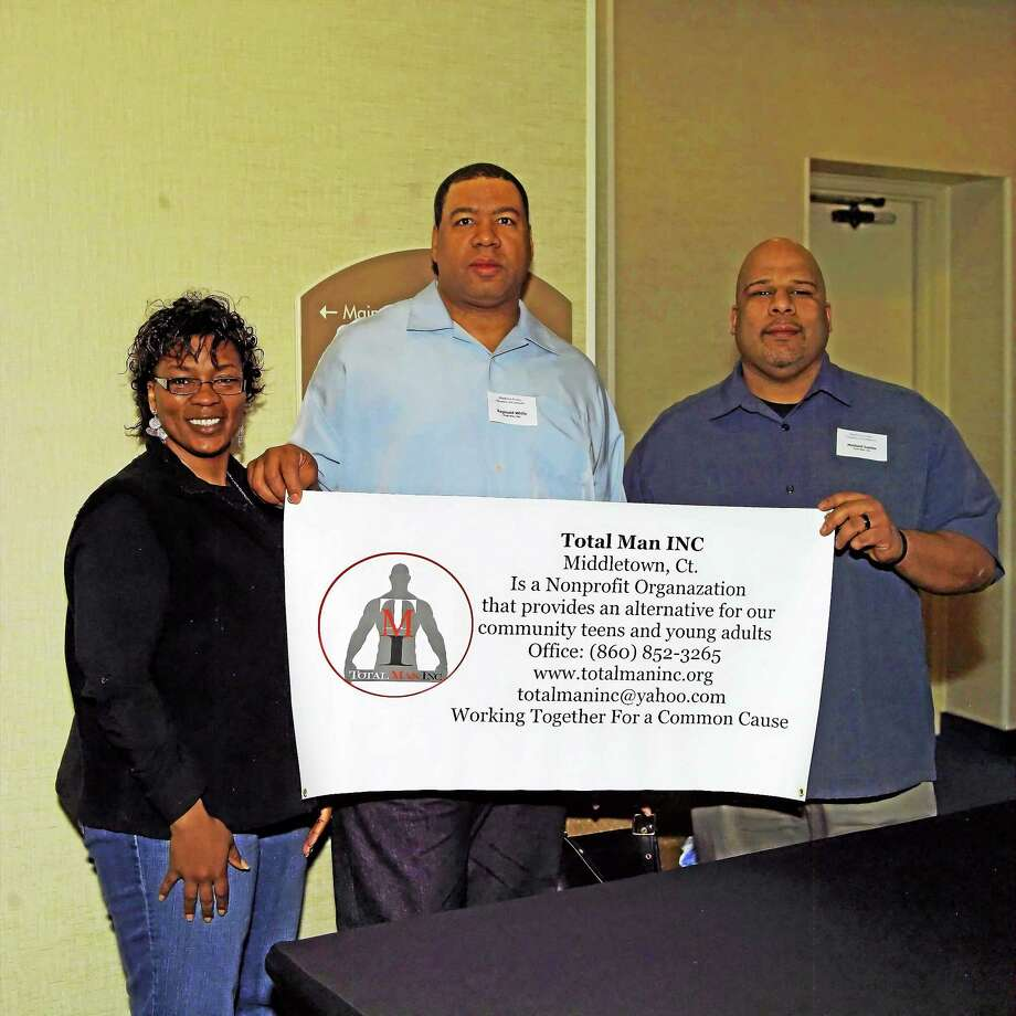 Submitted photo Anita Dempsey-White, Reginald White and Michael Luster, treasurer, celebrate the incorporation of Middletown's Total Man as an official nonprofit. Photo: Journal Register Co. / Rice Creek Photo