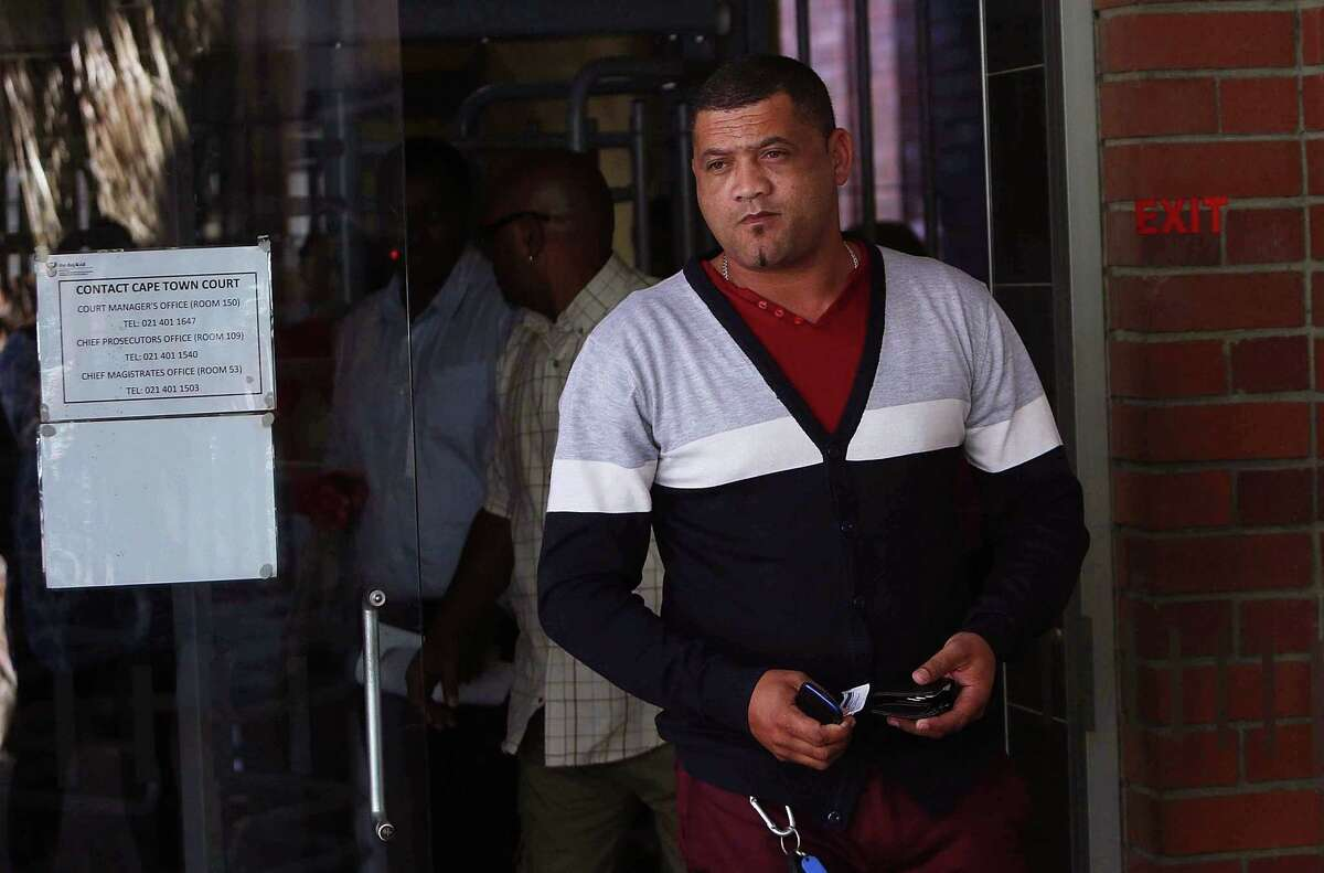 Morne Nurse the father of a girl that was kidnapped as a baby 17 years ago, leaves court after attending the appearance of a woman suspected of the kidnapping in Cape Town, South Africa, Friday, Feb. 27, 2015. South African police say a girl who was kidnapped as a baby 17 years ago, has been returned to her family. Police spokesman Andre Traut said that a 50-year-old woman was arrested and appeared in court on Friday morning in connection with the kidnapping. (AP Photo)