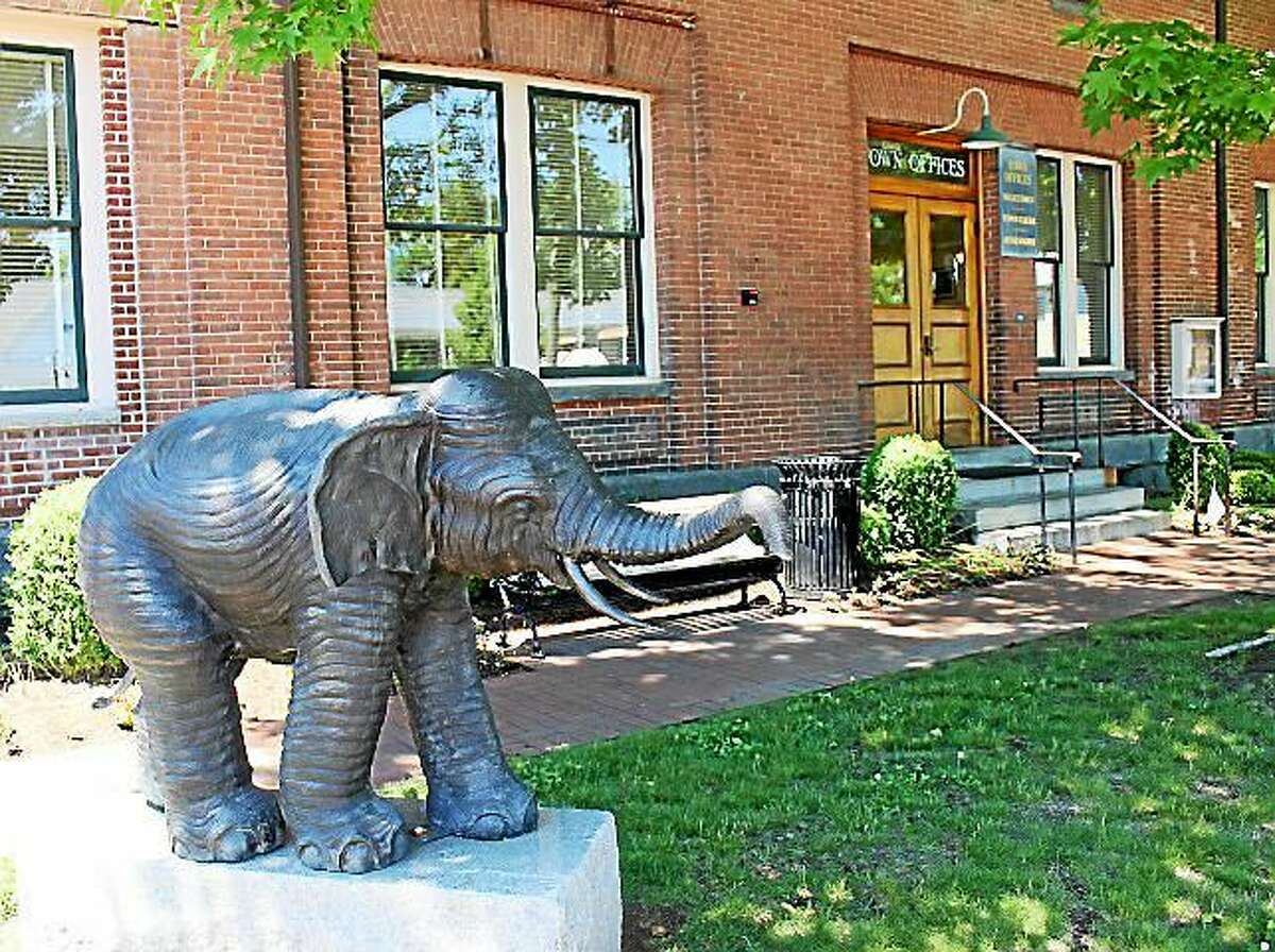 Here stands the bronze statue of an African elephant outside the Deep River Town Hall.