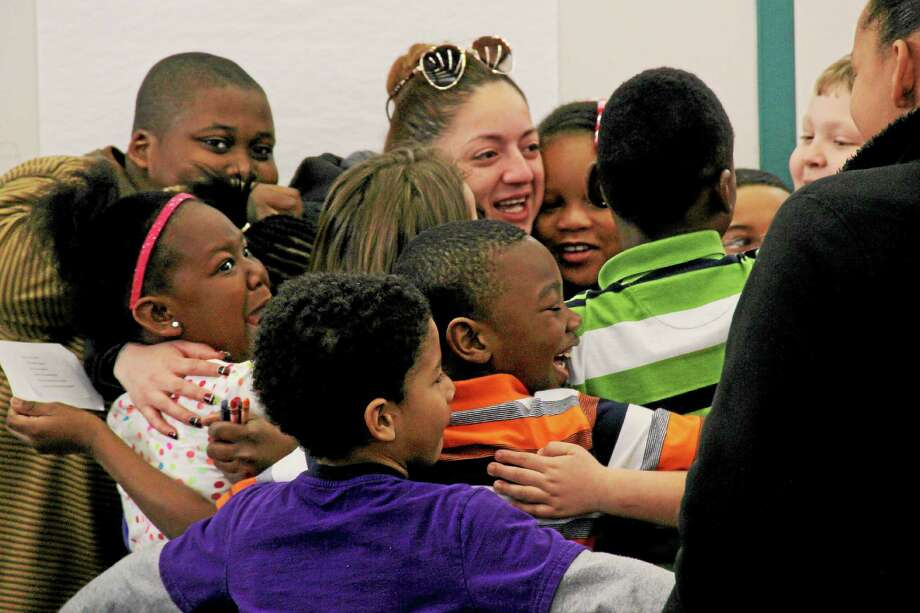 Screams of excitement erupt at Lawrence Elementary School as a group of students hugged DATTCO bus driver Wendy Valero. Photo: Kathleen Schassler — The Middletown Press  / Kathleen Schassler All Rights