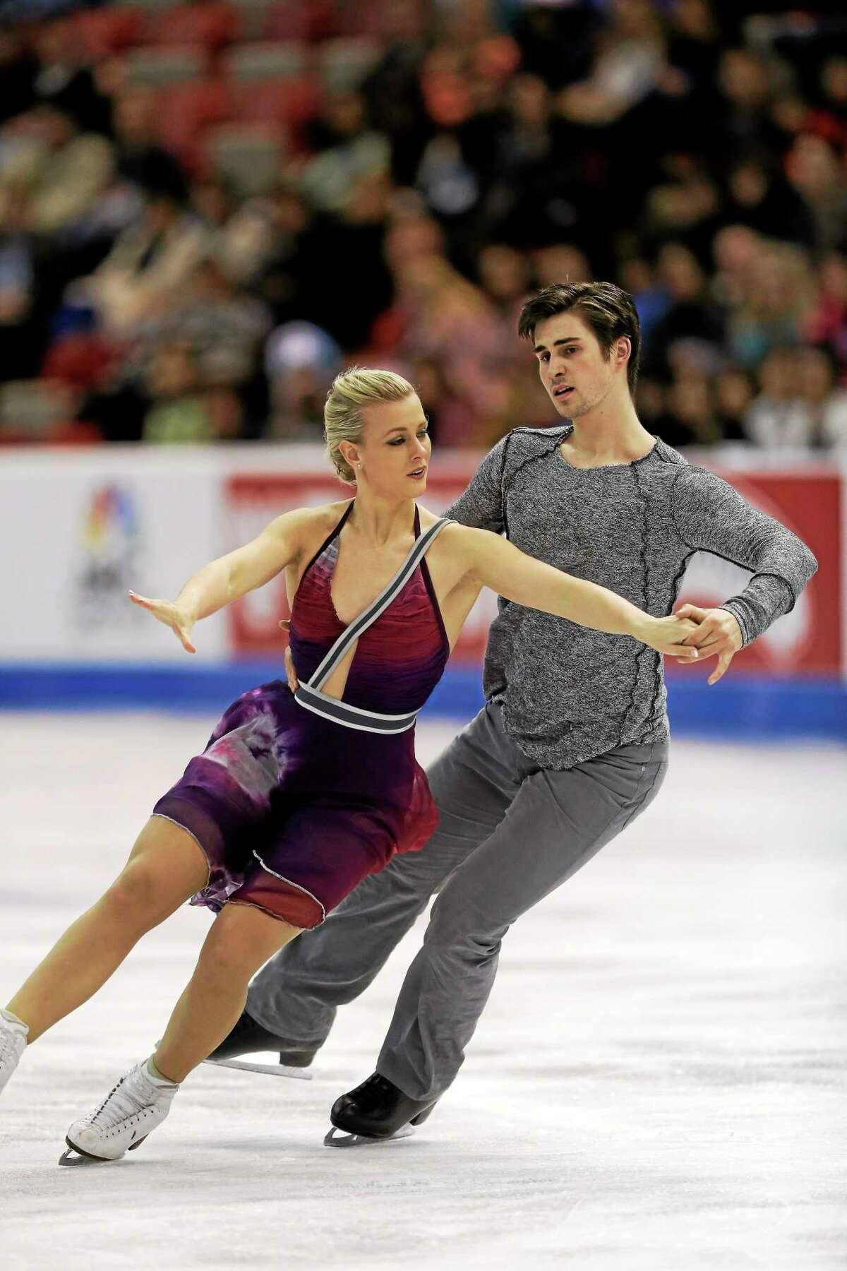 Madison Hubbell and Zachary Donohue compete in the ice dance free dance routine at the Skate America figure skating competition in 2013.