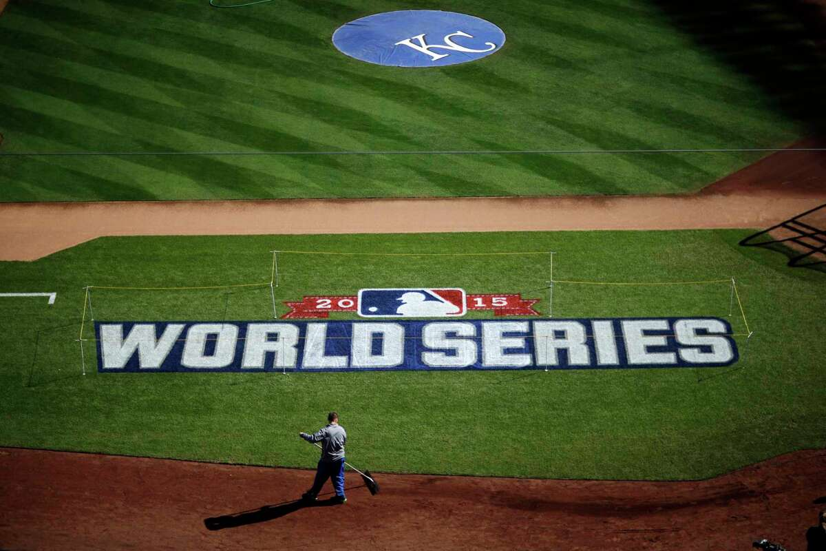 A worker gets Kauffman Stadium ready for the World Series Monday in Kansas City, Mo.