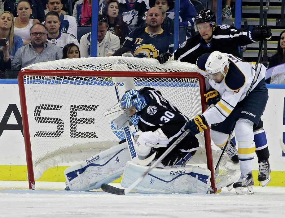 Tampa Bay Lightning goalie Ben Bishop ducks as the goal gets knocked over by Buffalo Sabres left wing Evander Kane during an Oct. 17 game in Tampa, Fla. Photo: Chris O'Meara — The Associated Press  / AP