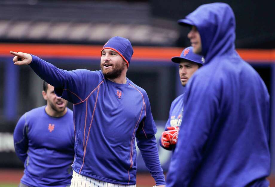 Mets second baseman Daniel Murphy, left, talks with teammates during a workout Saturday in New York. Photo: Julie Jacobson — The Associated Press  / AP