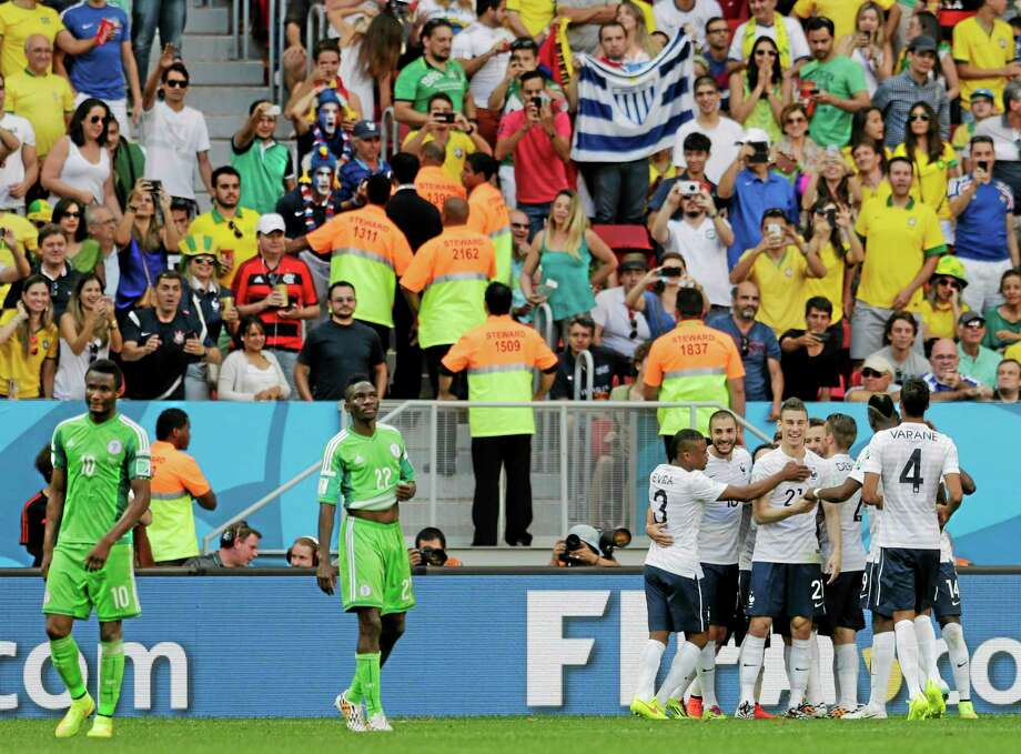 French players celebrate after Nigeria's Joseph Yobo scored an own goal during France's 2-0 victory during the World Cup Round of 16 match Monday at the Estadio Nacional in Brasilia, Brazil. Photo: Petr David Josek — The Associated Press  / AP