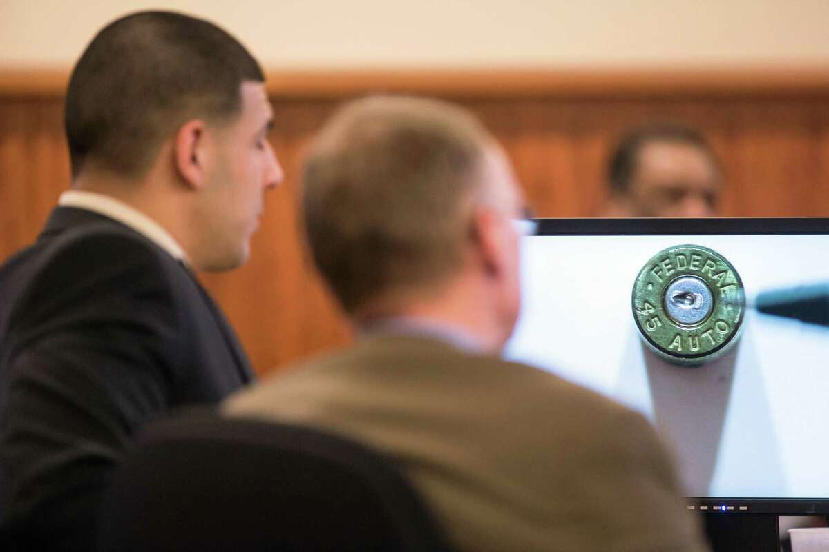 A bullet casing found at the murder scene is displayed as evidence in front of former New England Patriot Aaron Hernandez during his murder trial Wednesday at Bristol County Superior Court in Fall River, Mass.