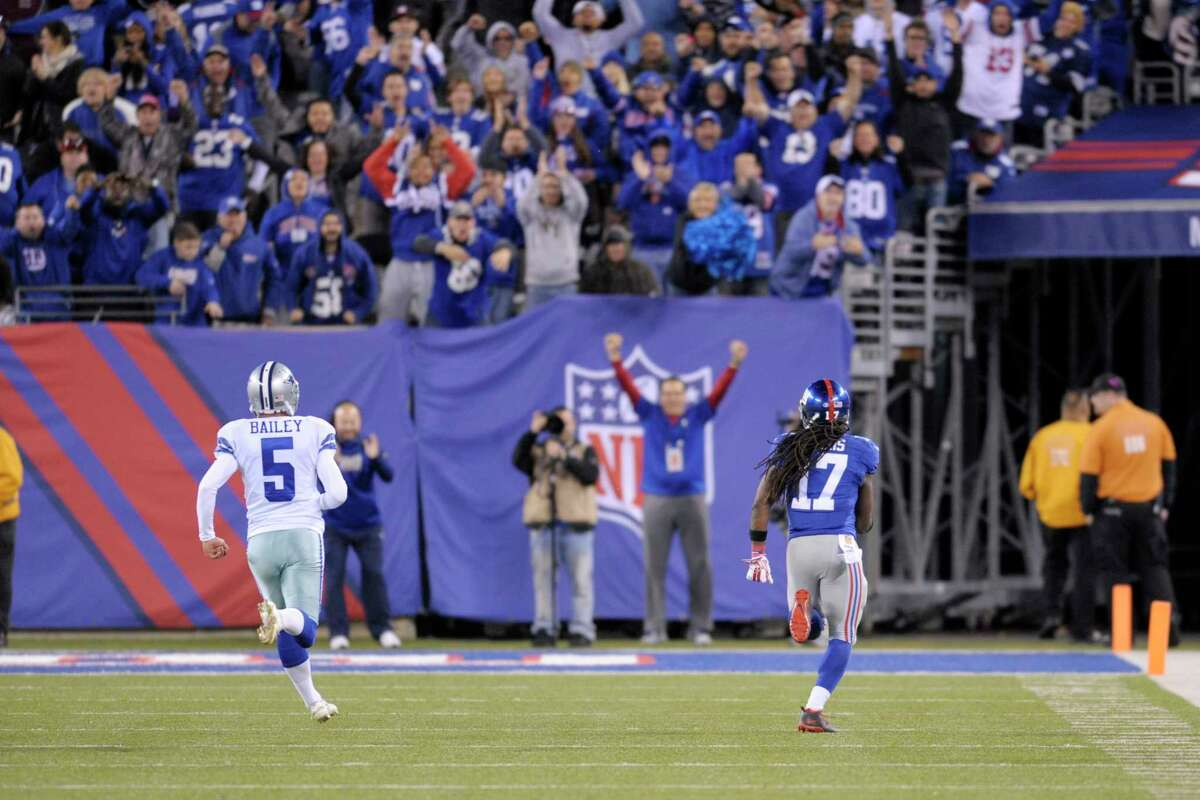 New York Giants kick returner Dwayne Harris is chased by Dallas Cowboys kicker Dan Bailey during the fourth quarter of Sunday's game in East Rutherford, N.J.